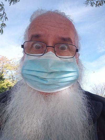 Portrait of man wearing eyeglasses against sky