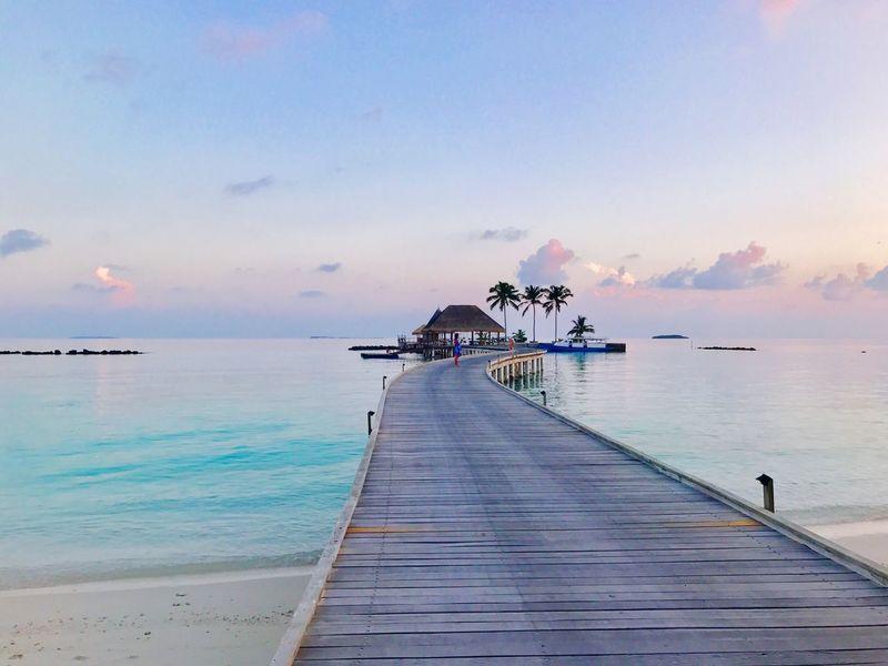 Maldives Sky Water Sea Beauty In Nature Scenics - Nature Sunset Tranquil Scene Horizon Cloud - Sky Beach Luxury Tranquility Horizon Over Water Transportation Architecture Land Nature