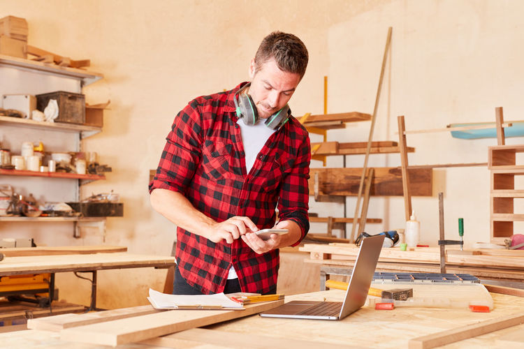 Full length of man working on table