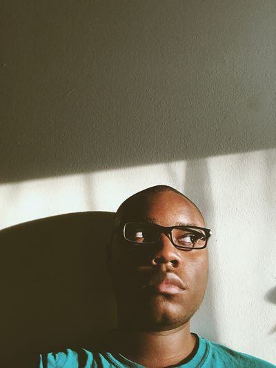 Close-Up Of Young Man Wearing Eyeglasses While Looking Away