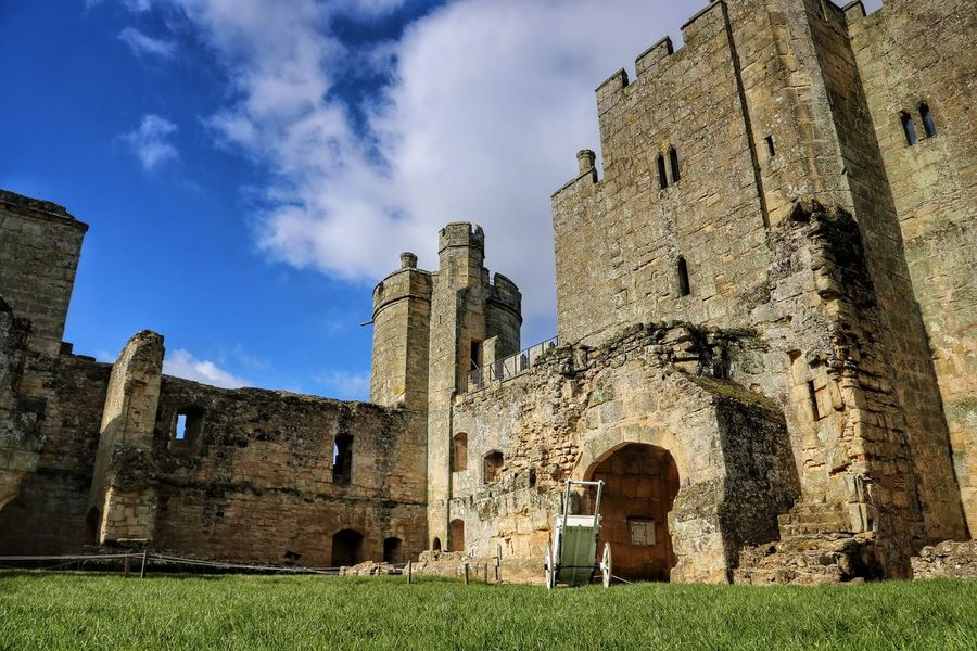 Architecture Built Structure Building Exterior History Old Ruin Old Grass Medieval Ruined Bodiam Castle Low Angle View Sky Outdoors Stone Wall Tower Blue Travel Destinations Church Day Damaged