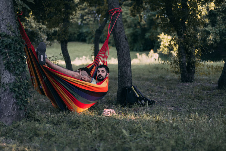 Hammock Outdoors Nature People Adult One Person Real People Adults Only Breathing Space Summer Looking At Camera Front View Modern Hospitality