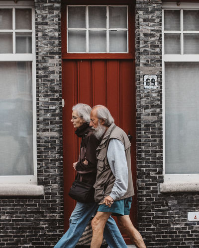 Adult Adults Only Architecture Bonding Building Exterior Friendship Gray Hair Love Outdoors People Senior Adult Senior Couple Senior Men Togetherness
