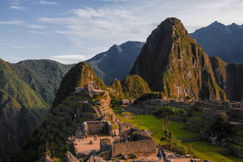 Sunset at Machu Picchu, Peru. Mountain of Huayna Picchu rising above Incan ruins of Machu Picchu - Sacred Valley. America Ancient Andes Architecture Building Culture Cusco History Inca Landmark Landscape Latin Machu Machu Picchu Mountain Old Buildings Past Peru Picchu Ruins South Southamerica Tourism Tourist Travel EyeEm Selects