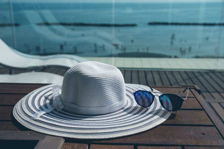 Chilling EyeEmNewHere Absence Close-up Clothing Day Focus On Foreground Hat Nature Nautical Vessel No People Outdoors Pool Security Selective Focus Still Life Sunlight Swimming Pool Table Water Wood - Material The Still Life Photographer - 2018 EyeEm Awards The Traveler - 2018 EyeEm Awards