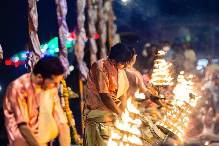 People Holding Lit Diya At Temple