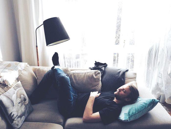 Mid Adult Man Sleeping Sofa At Home