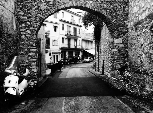 Embrace Urban Life Architecture City Scooter Urban Italy Taormina No People Outdoors IPhoneography IPhone Blackandwhite Photography Iphoneonly Love Transportation Travel Photography Lifestyles Vacations Tranquil Scene Road Arch Bestoftheday Photooftheday Iphonephotography
