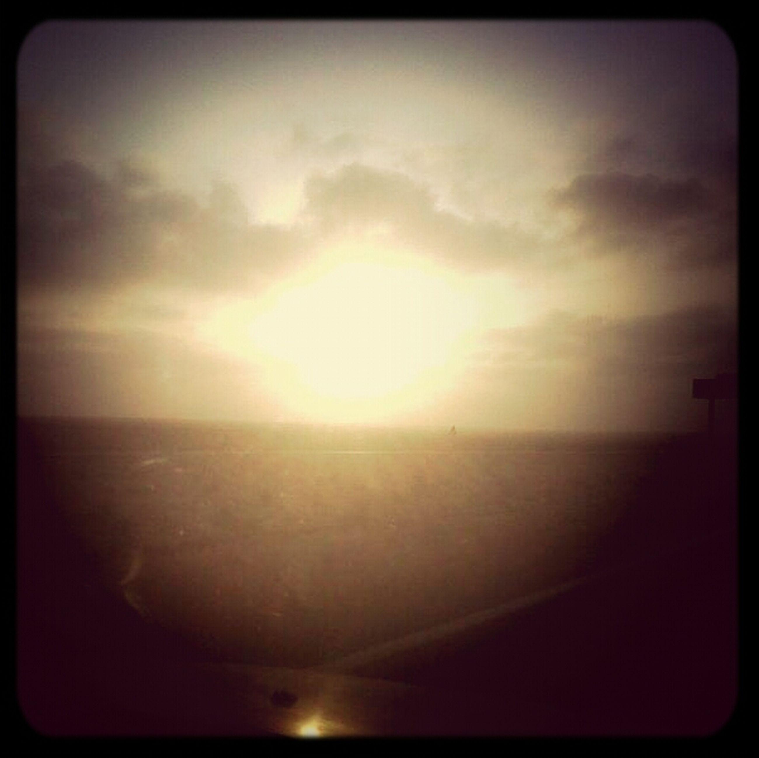 transfer print, sun, sunset, auto post production filter, sea, scenics, tranquil scene, horizon over water, sky, tranquility, beauty in nature, water, nature, beach, idyllic, sunlight, cloud - sky, sunbeam, shore, outdoors