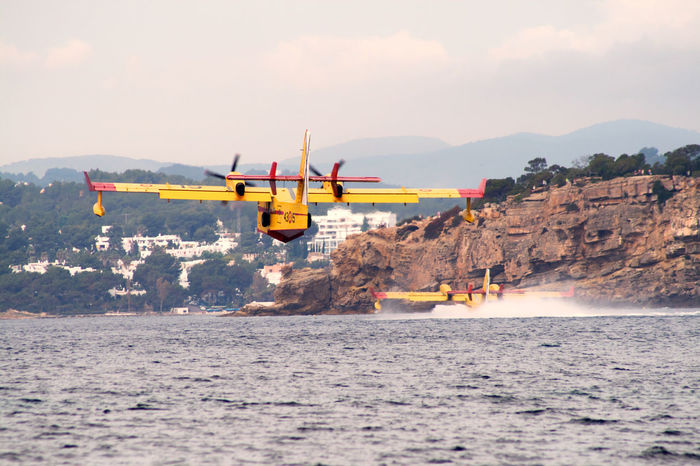 Beauty In Nature Blue Canadair Day Firefighter FireFighting  Flying No People Outdoors Red Sea Sky Transportation Water Yellow