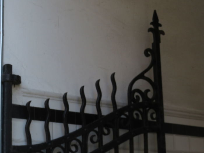 Close-up of railing against wall at home
