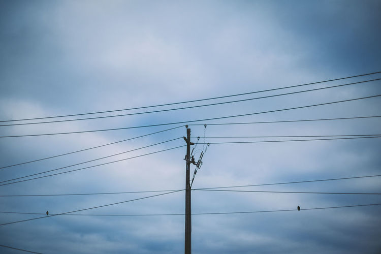 Birds Cable Cloud - Sky Cloudy Electricity  Low Angle View No People Pole Power Line  Power Supply Silhouette Sky Two