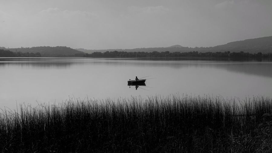 fishing.. A6000 Acqua Italy Lombardia Sony Luca Riva Pescatore Fhisher Water Lake Nautical Vessel Agriculture Men Rural Scene Reflection Sky Landscape Fisherman Standing Water Calm Fishing Equipment Fishing Boat