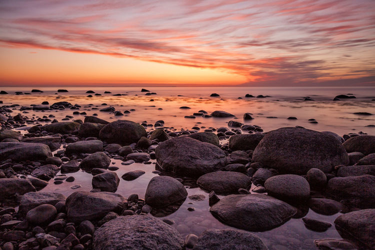 Stones on shore of the Baltic Sea. Beach Boulders Coast Day Evening Holiday Landscape Lohme Nature Nature No People Outdoors Romantic Sky Ruegen Rügen Shore Sky Stones Sundown Sunset Tourism Travel Vacation
