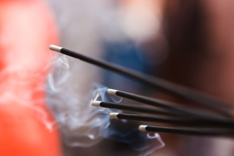 Close-up of incense stick in temple