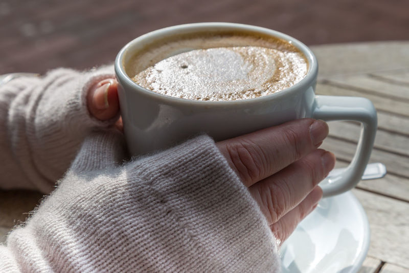 Gloved Hands Holding a Coffee Cup Winter Cappuccino Close-up Coffee - Drink Coffee Cup Day Drink Food Food And Drink Freshness Gloved Hand Gloves Holding Human Body Part Human Hand Lifestyles One Person Outdoors People Real People Women
