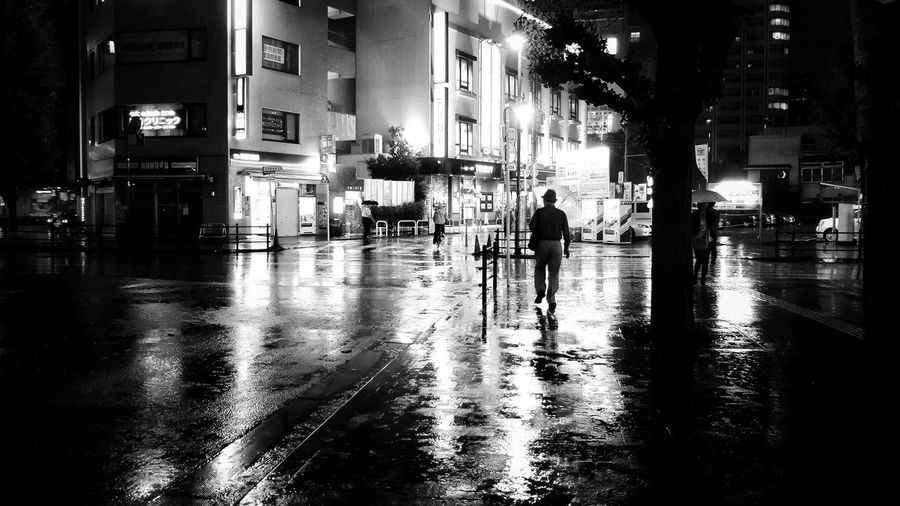 Wet and Cold Night Street Street Photography Streetphotography Alone Cold Lonely City Architecture Building Exterior Built Structure Street Wet Night Rain Illuminated City Life Water Incidental People Reflection Men Silhouette