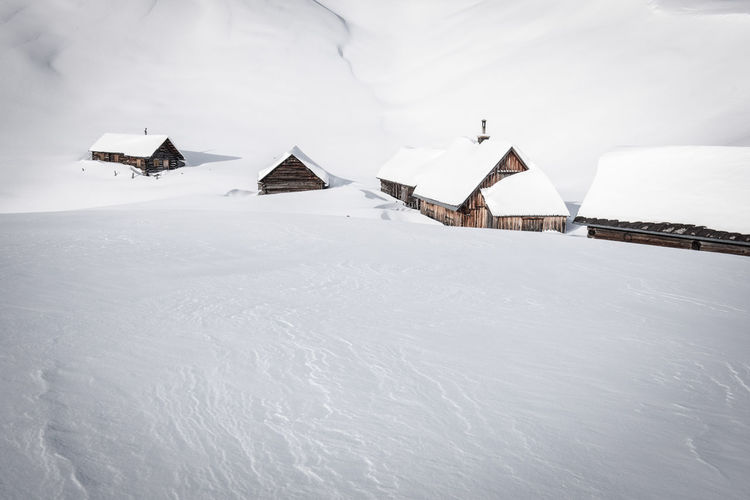 Untouched landscape with mountain huts Winter Cold Temperature Snow Built Structure Building Exterior Architecture Building House Day Scenics - Nature White Color Frozen Nature Landscape No People Environment Covering Beauty In Nature Outdoors Extreme Weather Mountain Huts