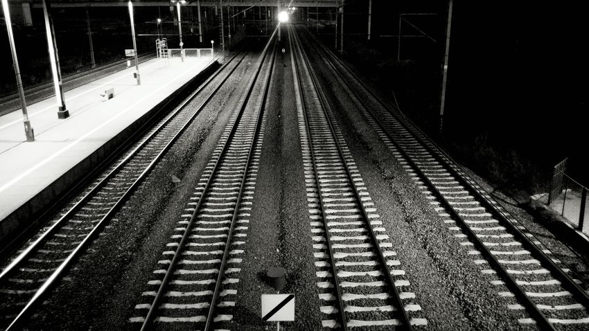 Waiting for the light Night Railroad Station Transportation Railroad Station Platform Railroad Track Track Railway Track Train Track Straight Long No People