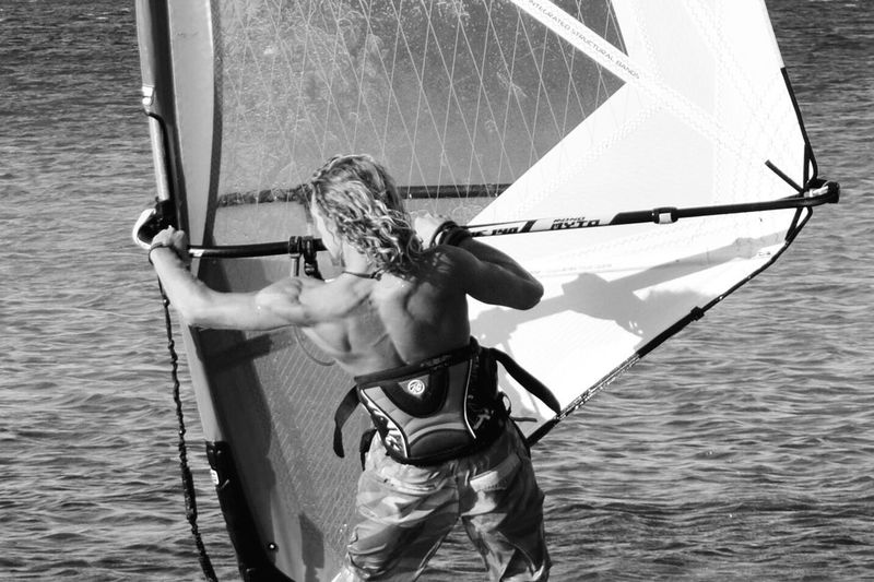 Man with boat sailing in sea