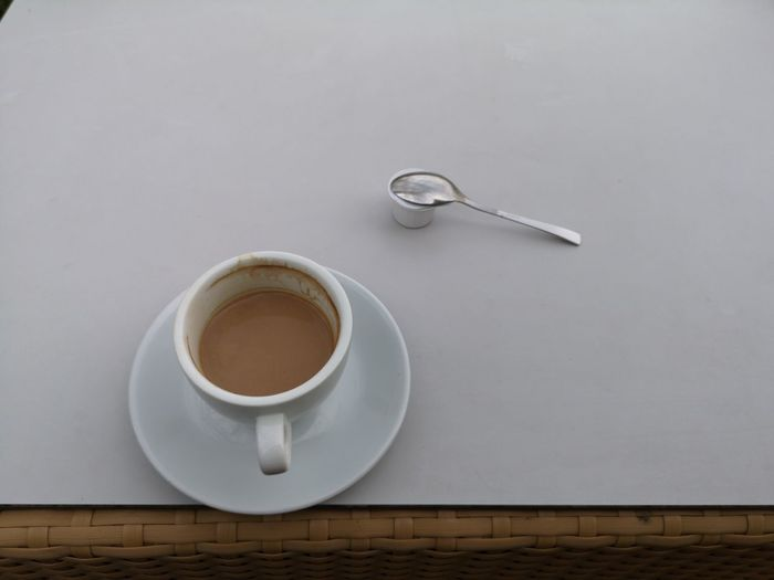 White half-filled coffee cup on white table - View from slanted top Copy Space Braided Coffee Cream Rattan Backgrounds No People Freshness Cafe Brown Wood - Material Consumption  Relish Half-filled Hot Beverage Cup Coffee-drink Table Breakfast Heat - Temperature Caffeine Coffee Cup Spoon White-background EyeEm Selects Coffee Break Coffee - Drink Coffee Cup Table Saucer