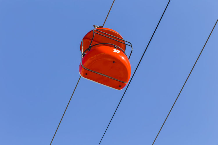 Low angle view of lantern against clear blue sky