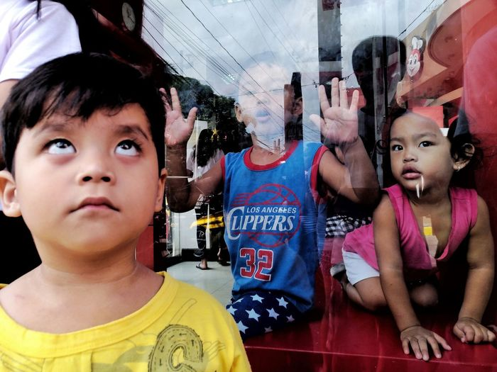 EyeEm Best Shots Eyeem Philippines Streetphotography Street EyeEm Selects Headshot Togetherness Portrait Looking At Camera Human Body Part Day People Childhood Outdoors Close-up Child The Street Photographer - 2018 EyeEm Awards