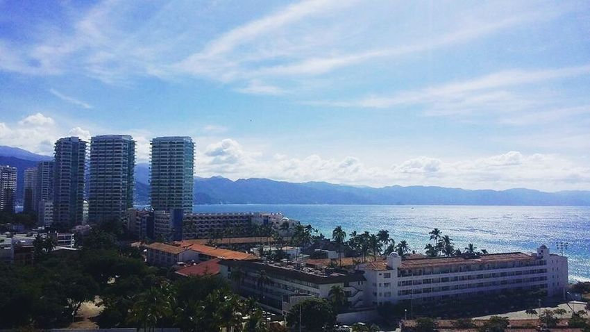 Puerto Vallarta La Mejor Vista Mar Pacífico Paraíso Sky Blue My House Love Vallarta Sea Building Exterior City Architecture Built Structure Cityscape Skyscraper Tree Water No People Outdoors Day Horizon Over Water Nature