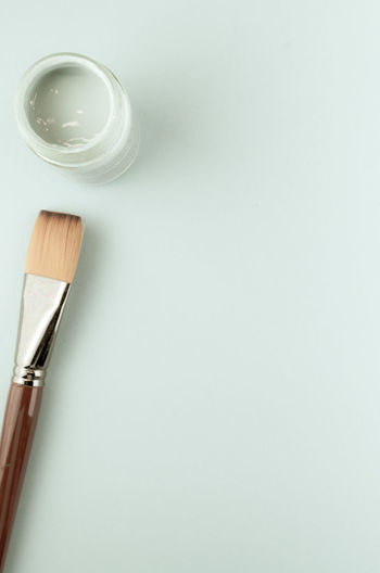 paintbrush and colors Art And Craft Brush Clean Close-up Copy Space Directly Above Eating Utensil Food And Drink High Angle View Household Equipment Indoors  Kitchen Utensil No People Paintbrush Simplicity Still Life Studio Shot Table White Background White Color Wood - Material