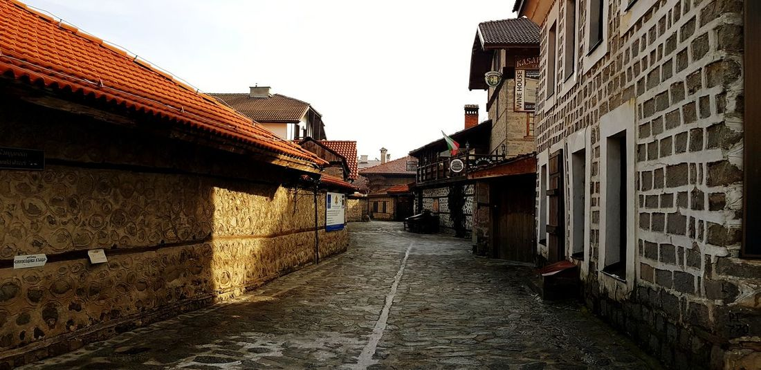 Bansko streets Building Exterior Old Old Buildings Bansko Bulgaria Winter Streetphotography Street Old City Building Old City Streets Outdoors Architecture Built Structure Building Exterior Alley Day The Way Forward Outdoors No People City