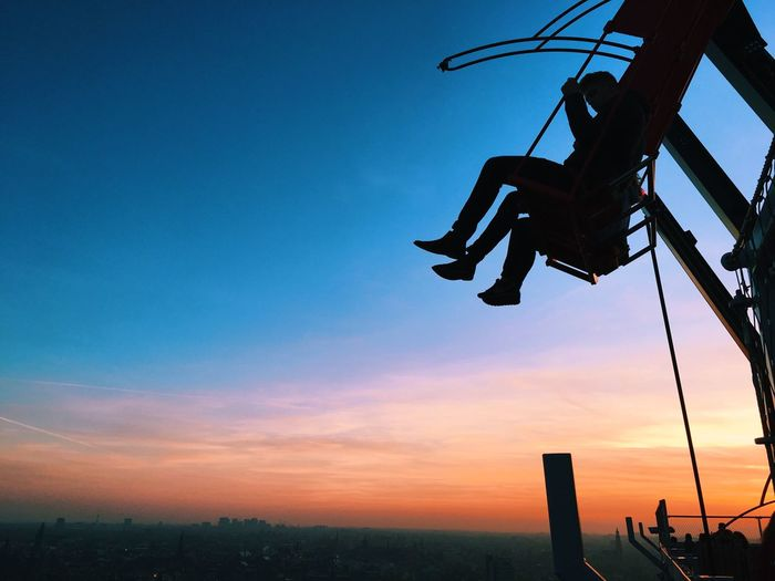 Sky Sunset Low Angle View Silhouette Outdoors Nature Technology Architecture Beauty In Nature Day Swing Amsterdam Skyline Horizon Over Water Horizontal Adventure View City Lifestyles Travel Colors