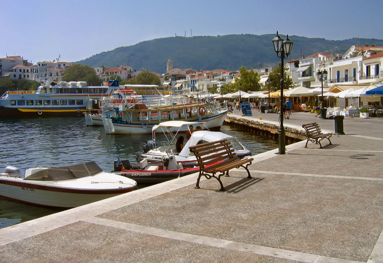View Of Boats Moored At Harbor In Town