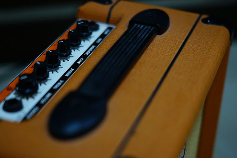 Close-up of guitar on table