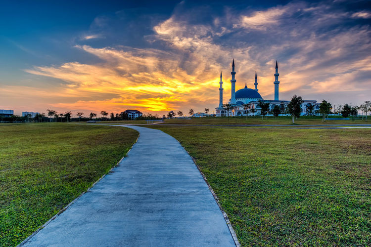 The Long Exposure Picture Of Great Mosque With The Golden Sunset As A Background Architecture Belief Building Building Exterior Built Structure Cloud - Sky Dome Grass Nature No People Outdoors Place Of Worship Plant Religion Sky Spire  Spirituality Sunset The Past Travel Travel Destinations