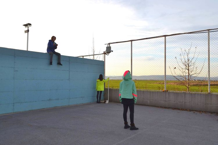 Full Length Fence Boundary Barrier People Men Leisure Activity Lifestyles Built Structure Rear View Real People Standing The Fashion Photographer - 2018 EyeEm Awards #urbanana: The Urban Playground The Street Photographer - 2019 EyeEm Awards