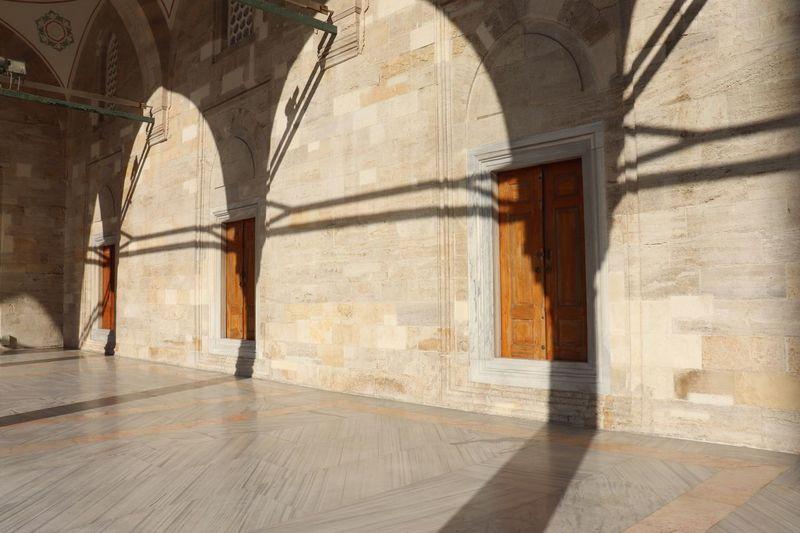 Sunlight falling on wall in church