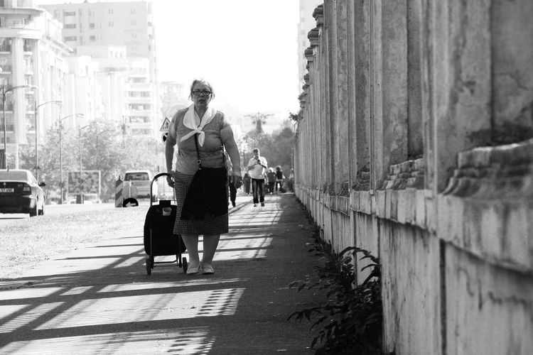 People of Romania Romania People City Adult Walking Streetphotography Street Photography Black&white No Colors Spontaneous Moments Love Photography