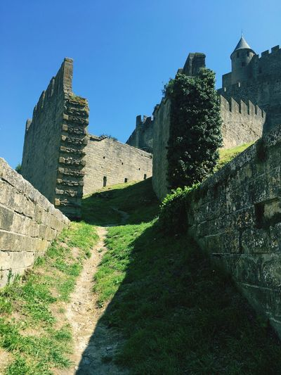 Architecture Built Structure History Building Exterior Ancient The Past Clear Sky Old Ruin Ancient Civilization Travel Destinations Low Angle View Fortified Wall Travel Tourism Day Medieval No People Castle Outdoors Grass Medieval Architecture Carcassonne Scenics Ancient Castle