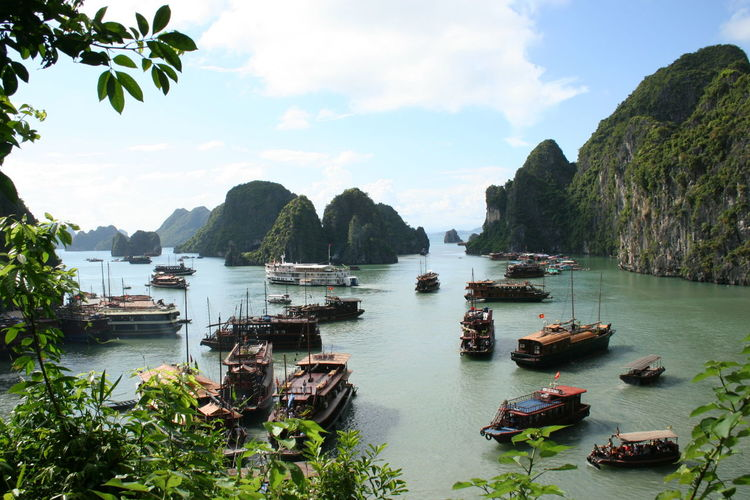 Boats In Halong Bay Against Sky