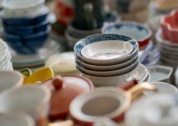 Close-up of crockery for sale at market stall