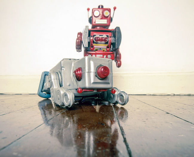 robot gets shot ! Crime Crime Scene Gun Man Down!! Ray Gun Reflection Childhood Flooring Hardwood Floor Indoors  Red Retro Style Robot Shooting Shot Still Life Tin Toys Toy Wood