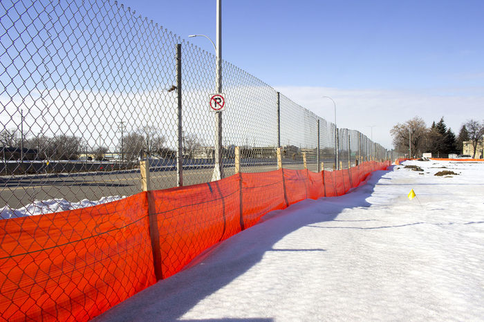 Bare Tree Chainlink Fence Clouds Composition Fence No People Outdoors Pattern Perspective Protection Safety Security Sky Snow Street Vacant Lot