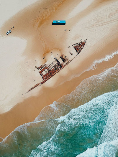 Aerial view of shipwreck on shore at beach