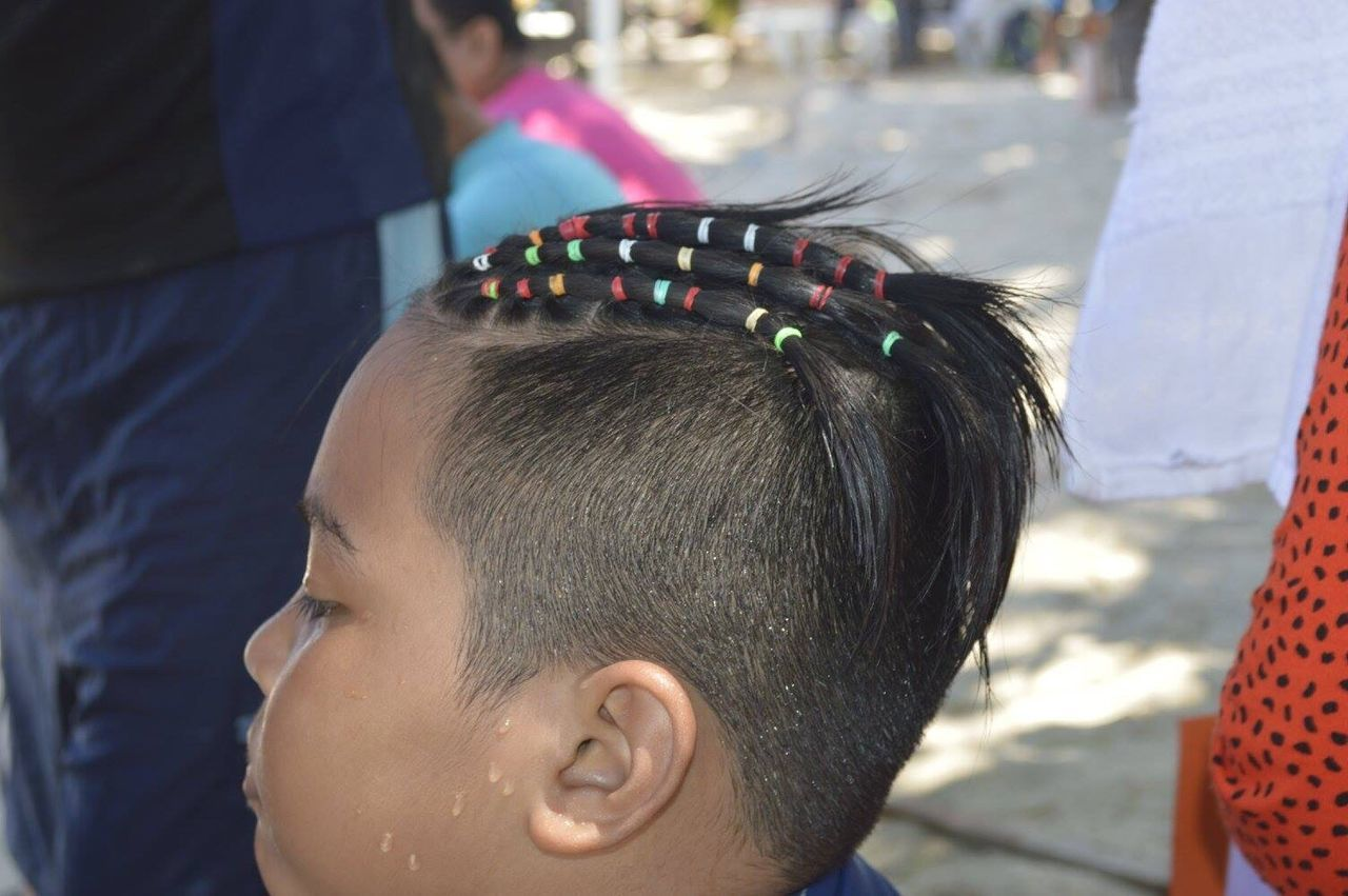 Close-Up Of Boy With Hairstyle