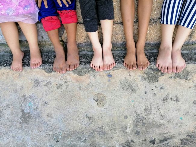 Happy children barefoot on concrete floor Group Of Children School Holidays Sitting Concrete Floor Kids Happy Childhood Girl Thailand Holiday Vacation Playing Recreation  Enjoy Lifestyles Friendship Low Section Child Togetherness Childhood Summer Boys Friend Children Female Caucasian Human Leg Human Foot Asian