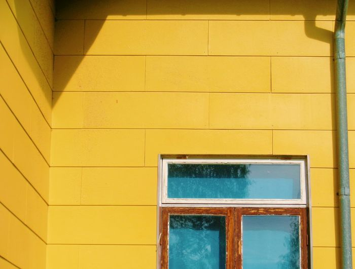 Yellow door of building