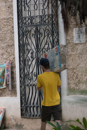 Delivery of the flatscreen Adult Adults Only Cuba Cuba Collection Day Flat Screen Habana Vieja Ironwork  One Man Only One Person Outdoors People Postman Real People Rear View Travelling Photography UNESCO World Heritage Site