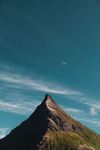 Lofoten Minimalistic Minimalism Bird Tourist Volanstinden Norway Mountains EyeEm Selects Sky Flying Beauty In Nature Nature Mountain Scenics - Nature Cloud - Sky Landscape Outdoors Land Travel