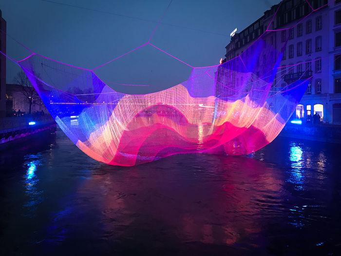 Digital composite image of illuminated swimming pool at night