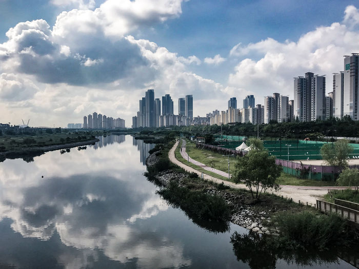 New City Tennis Court Bycicle Bycicle Ride Reflection Incheon Songdo,Incheon New City City Cityscape Urban Skyline Tree Modern Downtown District Sky Architecture